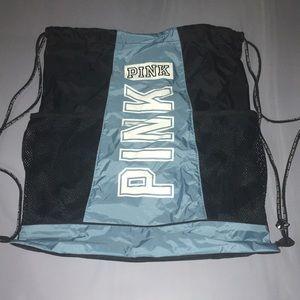 PINK string back pack in blue